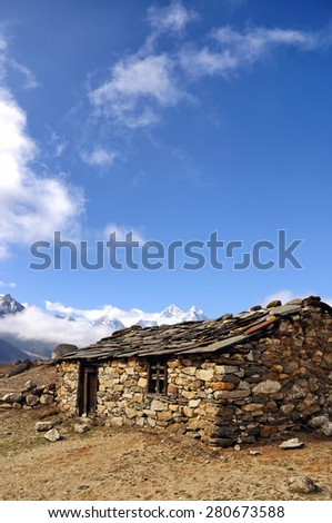 Old stone shed in mountains. Abandoned village in Himalayas. Trekking in Nepal. - stock photo