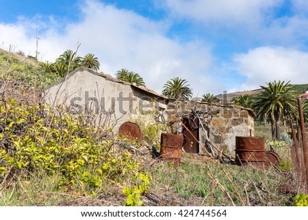 Old stone shed in the terraced gardens of El Cercado, a small village with a beautiful terrace landscape in the highlands of La Gomera. El Cercado is also well known as pottery town on the Canaries - stock photo