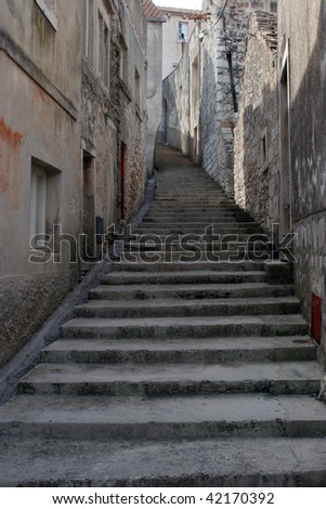 Old stone stairs on the street in dalmatia, Croatia.