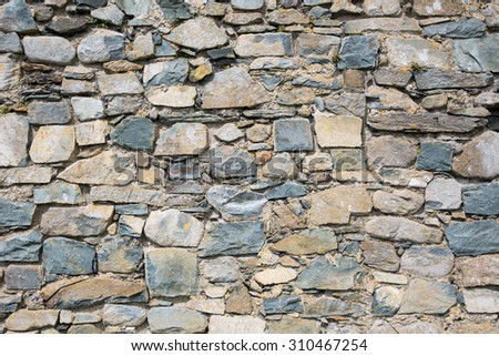 Old stone wall of castle ruins - stock photo