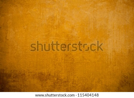Old stone wall painted in yellow,background - stock photo