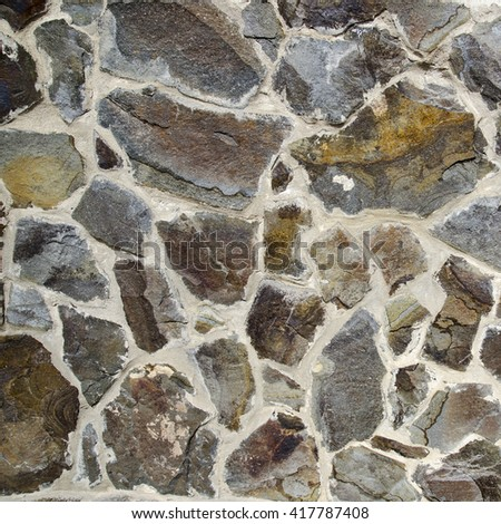 Old stone wall texture, different stones brought together - stock photo