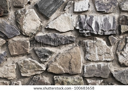 Old stone wall with large stones - stock photo