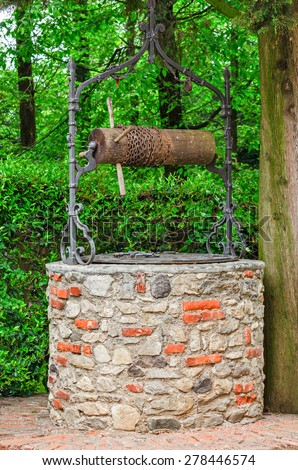 Old stone water well - stock photo