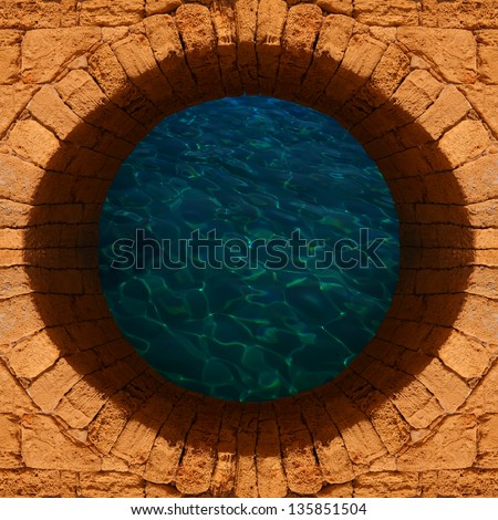 Old stone well with a deep water top view - stock photo