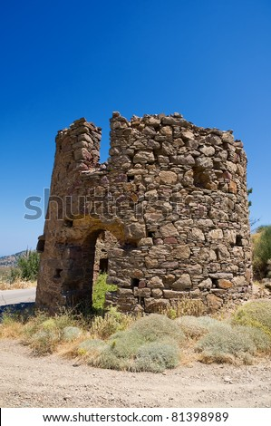 Old stone windmill on chios island - stock photo