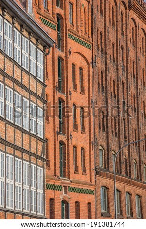 Old storehouses at the quay in Lubeck, Germany - stock photo