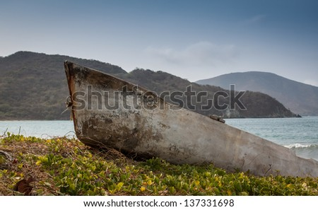 Old stranded boat outside Santa Marta, Colombia - stock photo