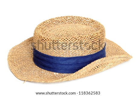 Old straw hat in front of a white background