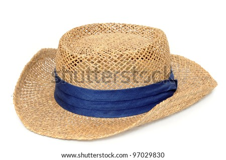 Old straw hat in front of a white background - stock photo