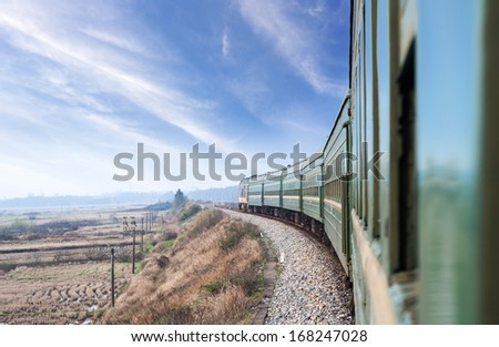 old stream train that runs through the countryside - stock photo
