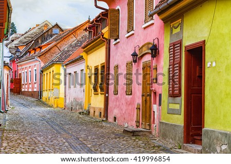 Old street form Shassburg, Transylvania from the medieval ages with colorful houses - world heritage.