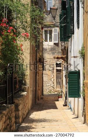 Old street in Corfu town - stock photo