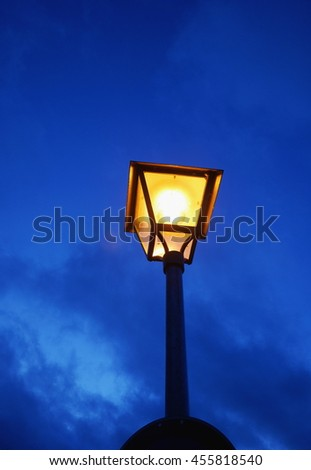 Old street lamp in the evening - stock photo