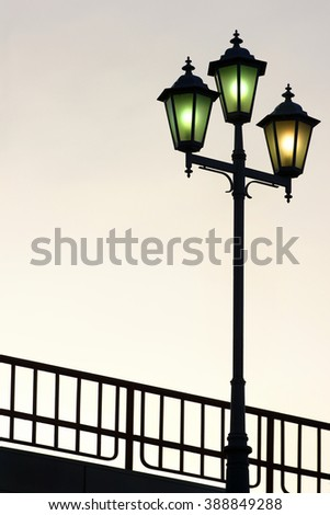 Old street lamppost against twilight background - stock photo