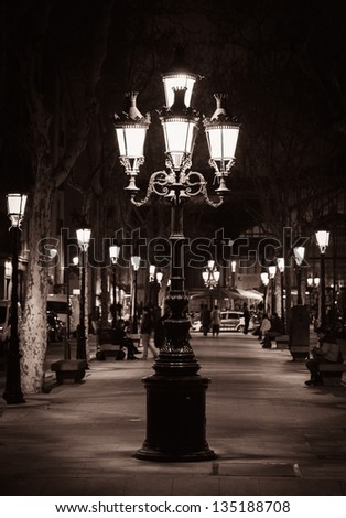 Old street light in a city of Barcelona - stock photo