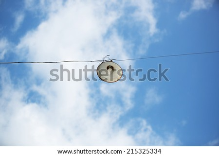 old street light lamp or lantern on blue sky and cloud background - stock photo