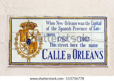 old street name Calle de Orleans painted on tiles in the French quarter in New Orleans - stock photo