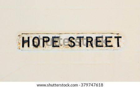 old street name on the wall - hope street - stock photo