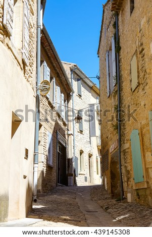 Old street of Gordes, a small typical town in Provence, France. Beautiful village, with view on roof and landscape - stock photo