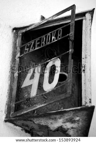 Old street sign marking Szeroka Street - main street in Jewish Kazimierz district of Krakow, Poland  - stock photo