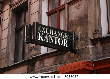 Old street signboard the money exchange in Torun, Poland. - stock photo