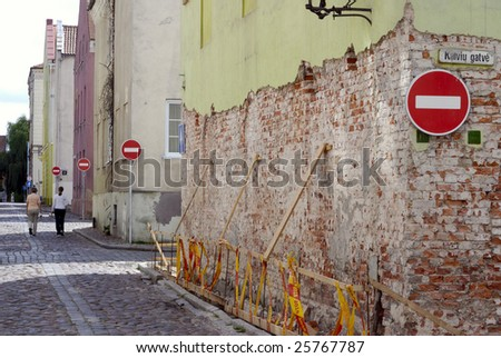 Old Street With Stop-Signs - stock photo