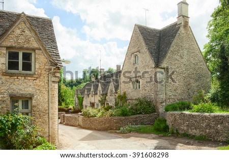 Old street with  traditional  cottages in Bibury,  England, UK. - stock photo