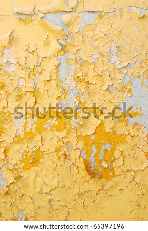 Old stucco yellow wall - stock photo