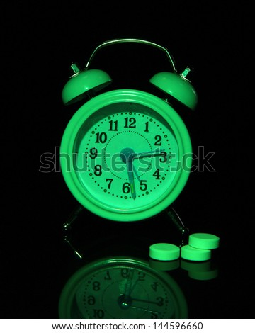 Old style alarm clock isolated on black