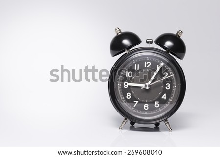 Old style Black Alarm Clock on White background