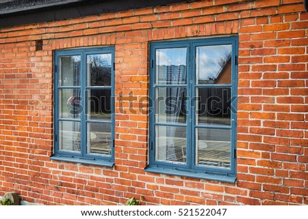 Old style brick wall and windows.
