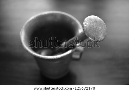 Old style bronze Mortar and pestle. - stock photo