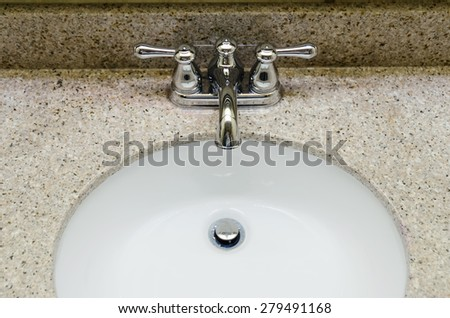 Old style Chrome Faucet and round sink in bathroom. Selective focus on a tap - stock photo