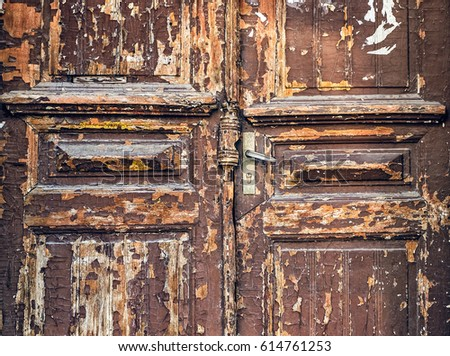 Old Style Door With Brown Peeled Paint