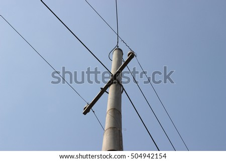 Old style electric pole with wires and blue sky