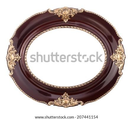 Old style elliptical shiny mahogany frame with golden decoration - studio isolated on white. - stock photo