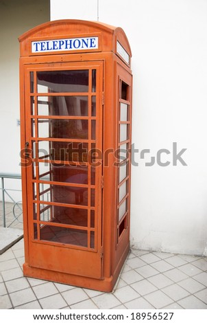 old style english telephone booth - stock photo