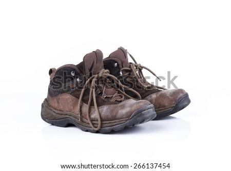 Old style hiking or adventure shoe isolated on white background  - stock photo
