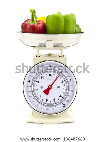 Old style kitchen scales with Pepper on white background Isolated - stock photo