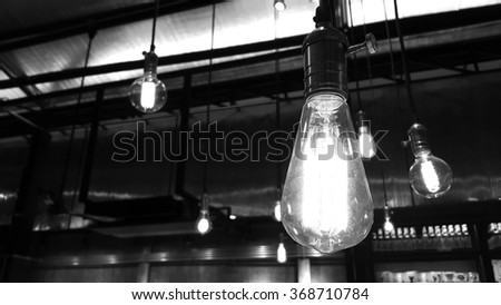 Old style light bulbs in black and white - stock photo