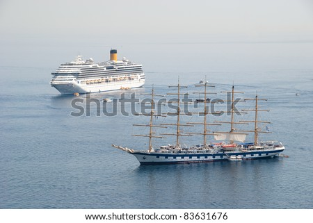 Old style mast ship along with a new huge cruise ship - stock photo