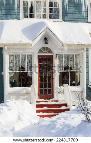 Old style north american home after the snow storm - stock photo
