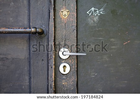 old style padlock on steel garage gate, vintage object and background