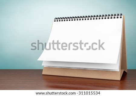 Old Style Photo. Blank paper desk spiral calendar on the table - stock photo