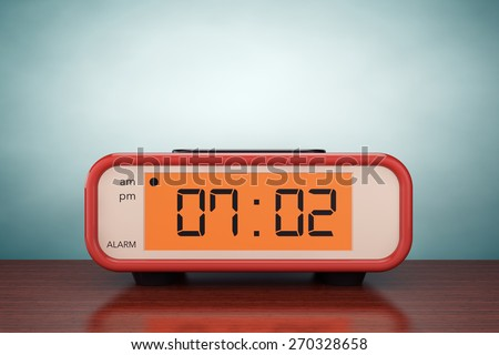 Old Style Photo. Digital Alarm Clock on the table