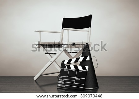Old Style Photo. Director Chair, Movie Clapper and Megaphone on the floor - stock photo