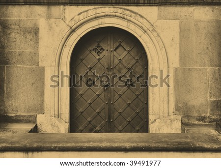 Old style photo of door. The Wawel Royal Castle in Cracow, Poland. - stock photo