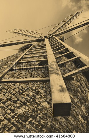 old style photo of windmill in Poland
