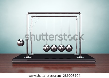 Old Style Photo. Perpetual Motion Spheres of Newton on the table - stock photo